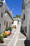 Narrow street in the Alpujarras with white houses  Stock Image