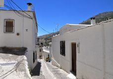 Narrow street in the Alpujarras with white houses. Narrow street in the Alpujarras with typical white houses , Andalusia, Spain Stock Image