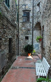 Narrow street in Ameglia town. Ameglia town in Liguria, Italy, view of the street in old town Royalty Free Stock Images