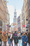 Narrow street of Amsterdam crowded with tourists Stock Photos
