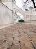 Narrow street with ancient buildings and stone pavement Stock Images