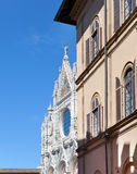 Narrow street with ancient houses and a Catholic cathedral. Italy. Stock Photo