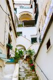 Narrow street with ancient stairs in the Amalfi town, southern Italy. Narrow street and courtyard in Amalfi town, southern Italy - Stairs lead to the doors of Stock Image