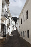 Narrow street in Andalusian village Royalty Free Stock Photos