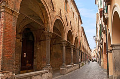 The narrow street with arcades. PADUA, ITALY - APRIL 23, 2012: The arcades are important detail of the architecture of the city, it's easy to find them on all Stock Photos