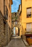 Narrow street with arch at end in medeival town of Royalty Free Stock Images