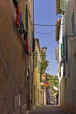Narrow street in Asciano, Italy Royalty Free Stock Photos