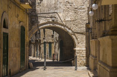 Narrow street. Bari, Puglia, Italy. Narrow street with an arch in the old town of Bari, Puglia, Italy Stock Photography