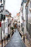 Narrow street in the Barrio Alto in Lisbon Stock Photography
