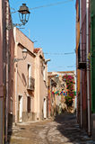 Narrow street in Bosa Stock Photography