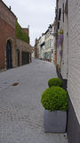 Narrow street in Bruges in Belgium Royalty Free Stock Images