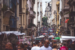 The narrow street of Buenos Aires is crowded with people. Shevelev. Royalty Free Stock Images