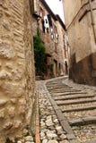 Narrow street between buildings. A narrow street between buildings with steep stairs in Narni (Umbria, Italy royalty free stock images
