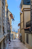 Narrow street between buildings in city. Picture of narrow isola Royalty Free Stock Photography