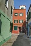 A narrow street in Burano Stock Photo