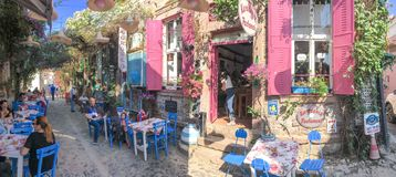 A narrow street cafe in old touristic town, Cunda Alibey Island, Ayvalik.  It is a small island Stock Photos