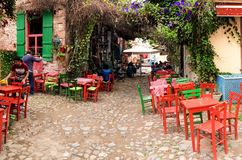 A narrow street cafe in old touristic town, Cunda Alibey Island, Ayvalik.  It is a small island Royalty Free Stock Photography