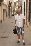 On a narrow street of Calella Royalty Free Stock Image