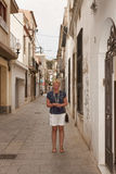 On a narrow street of Calella Stock Images