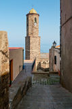 Narrow street in Castelsardo fortress, Sardinia, Italy Stock Images