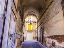Narrow street in Catania city, Sicily, Italy Stock Image