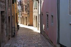 Narrow street in Croatian city royalty free stock photography