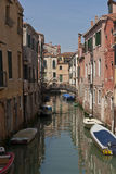 The narrow street - channel in Venice Stock Photography