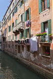 The narrow street - channel in Venice Stock Photo