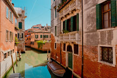 The narrow street - channel in Venice, Italy Stock Images