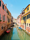 The narrow street - channel in Venice, Italy Stock Image