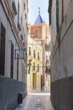 Narrow street and church, Malaga, Royalty Free Stock Photography