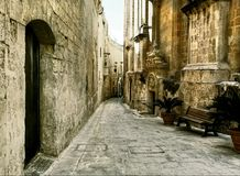 Narrow street with in the city M'dina on the island of Malta Royalty Free Stock Image