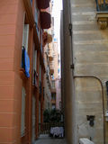 Narrow street in the city of Monte Carlo, Monaco. With old rundown walls royalty free stock photo