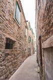 Narrow street in city Vodice. stock photos