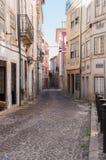 Narrow street of Coimbra Stock Images