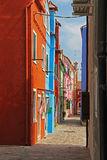 Narrow street with colorful apartment houses in Burano, Venice, Italy Royalty Free Stock Photography