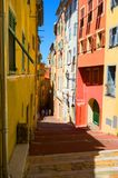 Narrow street with colorful buildings on day. Color street narrow buildings yellow white view Royalty Free Stock Image