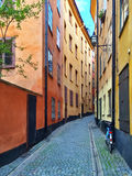 Narrow street with colorful buildings in Stockholm Royalty Free Stock Images
