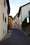 Narrow street in Conegliano Veneto, Italy. Medieval narrow street and historical buildings in Conegliano Veneto city, in Veneto, Treviso, Italy Stock Images