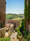 Narrow street in Cordes sur ciel and hilly countryside Stock Photo