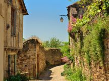 Narrow street in Cordes sur Ciel medieval city. A narrow street in Cordes sur Ciel, a small medieval city on a hill in Southern France, near Albi and Toulouse Royalty Free Stock Photography