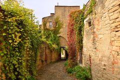 A narrow street in Cordes sur Ciel, a small medieval city on a h Stock Image