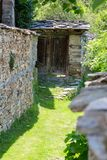 Narrow street covered with grass between old stone walls royalty free stock photos
