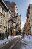 Narrow Street Covered in Snow in Quebec City Stock Image