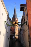 Narrow street in deventer, the netherlands. With christmas decoration and church in the background Royalty Free Stock Photography
