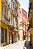 Narrow street of european city.  Girona Royalty Free Stock Photos