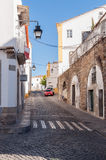 Narrow street of Evora in Portugal Stock Photography
