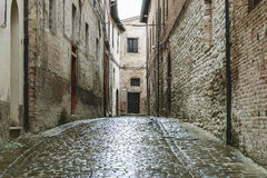 Narrow street in Fabriano. Narrow street in village Fabriano in Italy, Marche after rain Stock Photo