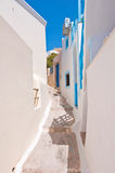 Narrow street in Fira town on Santorini (Thira), Greece. Stock Photos