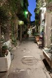 Narrow street with flowers in the old town Mougins in France. Ni. MOUGINS, FRANCE - OCTOBER 31, 2014: Narrow street with flowers in the old town in France. Night royalty free stock photos